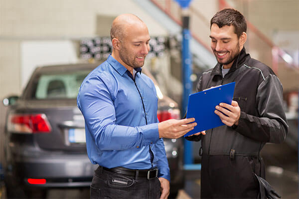 car mechanic with customer